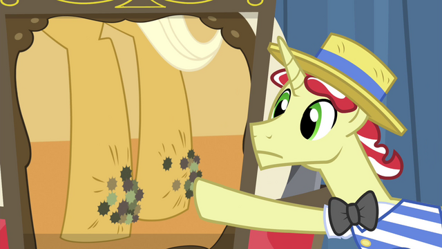 File:Flim pointing at picture showing a pony with leg infections S4E20.png