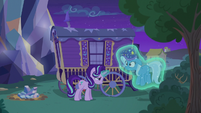 Starlight Glimmer levitates Trixie out of her wagon S6E25