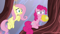 Pinkie Pie breathes heavily into a balloon S5E19