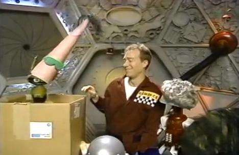 File:MST3k- Fugitive Alien host segment- Crow Has Dr. F' head.jpg