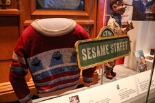 Smithsonian sweater and sign