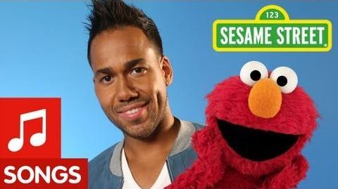 """Sesame Street Romeo Santos and Elmo sing """"Quiero Ser Tu Amigo"""""""