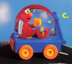 Enesco 1993 snowglobe car elmo