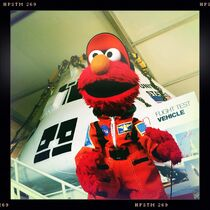 Elmo NASA flight suit