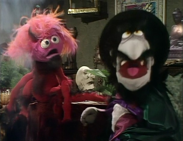 File:Pink Creature and Magician.jpg