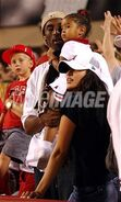 Kobe looking at wife and daughter Vanessa and Natalia as they look at the game