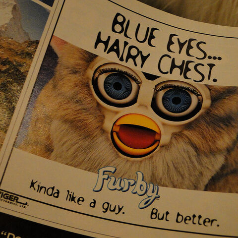 An advertisement in a parenting magazine, using a Wolf Furby with Blue Eyes.