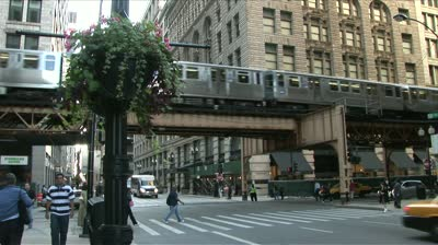 File:Stock-footage-chicago-il-circa-september-a-busy-street-scene-with-an-elevated-train-passing-through-the.jpg