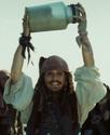 Jack Holding Up Jar of Dirt