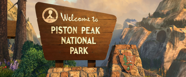 File:PistonPeakWelcomeSign.png