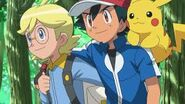 Clemont helping Ash stand straight