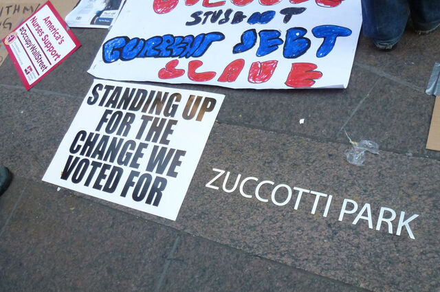 File:Sign- standing up for change1.jpg