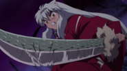 InuYasha wielding the Dragon-Scaled Tessaiga