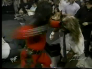 Fake Kane punches Mankind