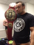 207495 Scott Fusion as RQW Tag Team Champ
