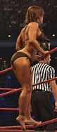 Mickie James - tan swimsuit