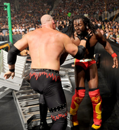 Kane choking Kofi