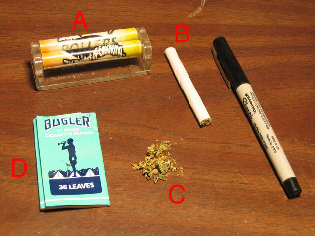 File:Spliff rolling machine papers pen.triddle.jpg