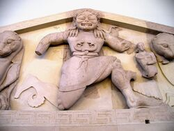 Close up of Gorgon at the pediment of Artemis temple in Corfu