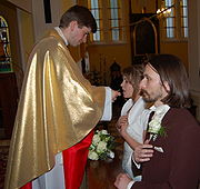File:Ejdzej and Iric wedding communion-01.jpg