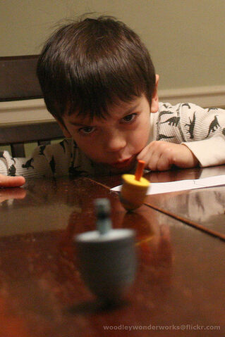 File:Learning to spin the dreidel.jpg