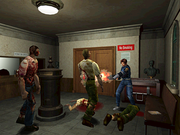 A young Caucasian police officer is defending himself against a group of attacking zombies with a shotgun. The scene takes place in a small room decorated with pieces of art.