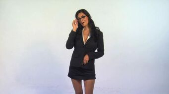 Tera Patrick with glasses in promo for Saints Row 2