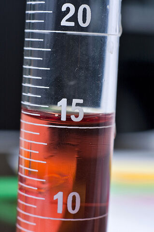 File:Red substance in half filled test tube.jpg