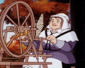 Puritan woman on spinning wheel