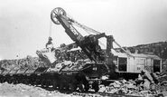 1935 - steam shovel loading ore cars