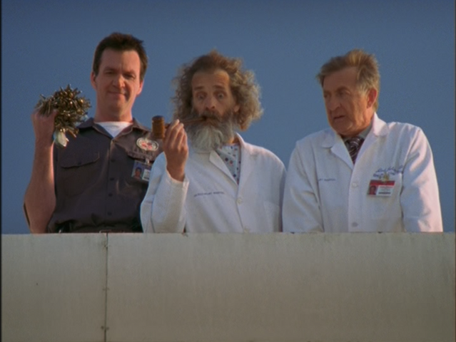 File:4x24 Janitor Kelso on roof.png