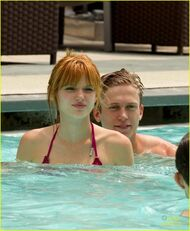 Bella-thorne-pink-bikini-with-boyfriend-in-the-pool