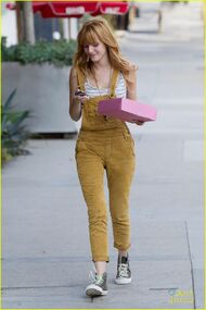 Bella-thorne-yellow-overalls-coffee-pink-box-(3)
