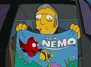 The Simpsons Fat Tony holding a Finding Nemo Poster