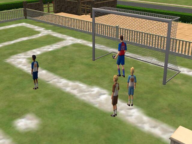 File:Boys playing football.JPG