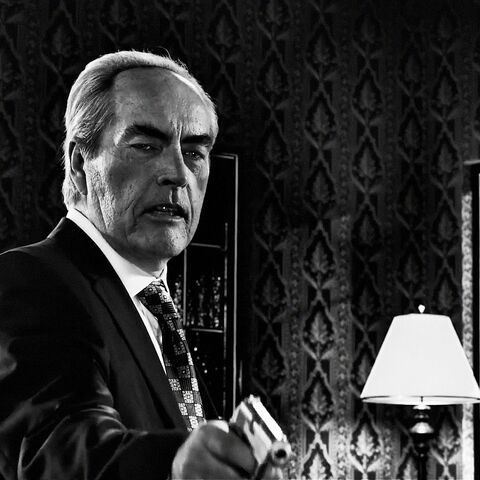 Senator Roark (Powers Boothe) uses a stainless Walther PPK.