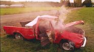 Splinter black truck wrecks red truck