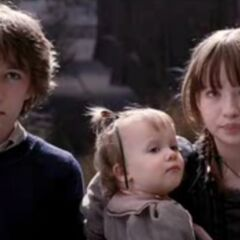 Violet and Klaus with Violet holding Sunny