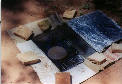 File:Hole in the ground box cooker built by Kristen Rahn.jpg