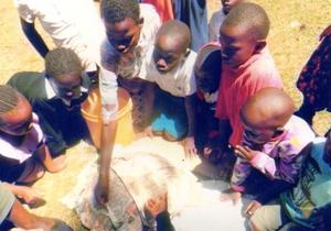 Students in Eldoret, Kenya make paer mache cooker bases, 2-17-16