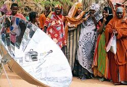 Parabolic cooker in refugee camp 2004