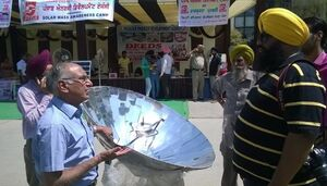Sarvesh Chadda at solar cooking demonstration, 7-7-14