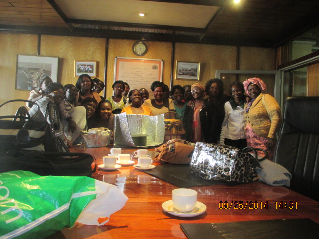 File:Mama Solar poses with Alliance women in coffee, 10-18-14.jpg