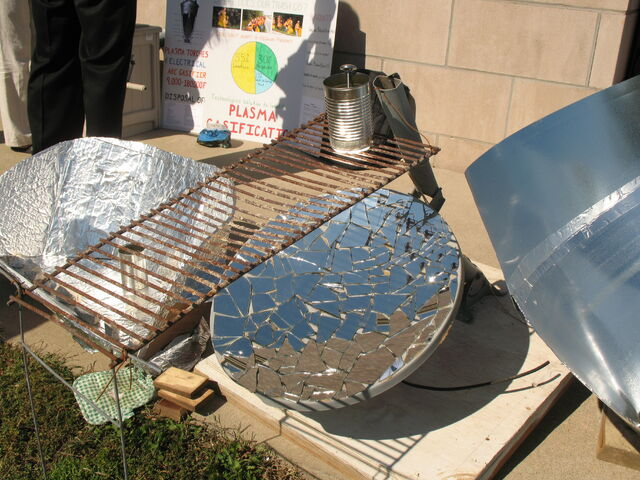 File:Close up of mirror mosaic parabolic cooker.jpg