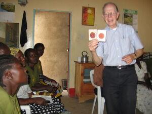 Professor Metcalf teaching water testing methods