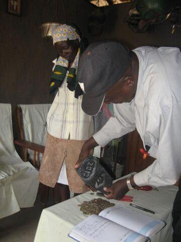 File:Geting ready to count jane nyamboks savings of 2&half months kshs.2060.00.jpg