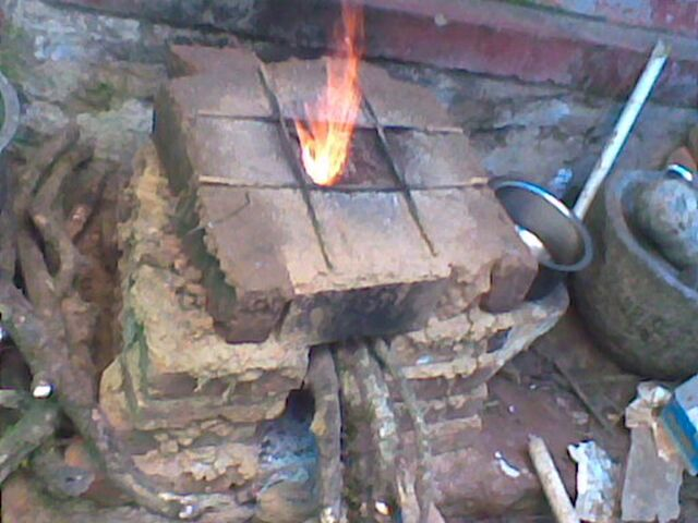 File:Wood burning stove .jpg
