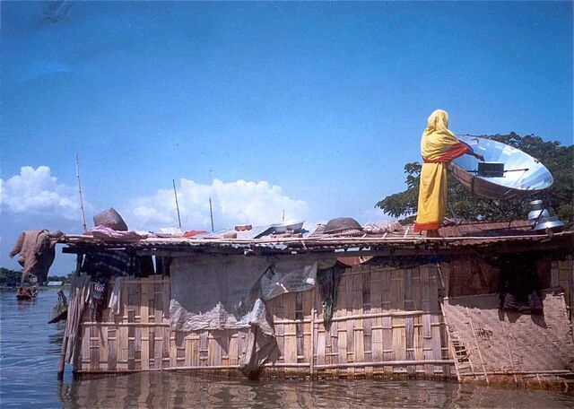 File:Bangladeshi woman cooking in flood.jpg