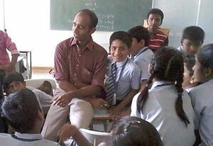 Vivek Kabra explains the benefits of solar to young students, 1-23-14