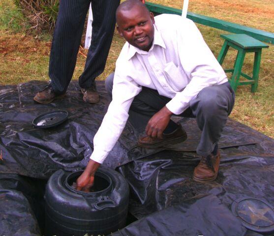 File:Peter Mwathi solar water heater, 2-17-12.jpg